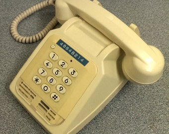 vintage french push button cream telephone