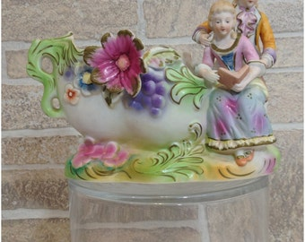Colorful Ucagco couple with book planter