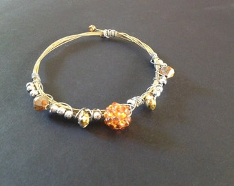 A recycled guitar string bracelet