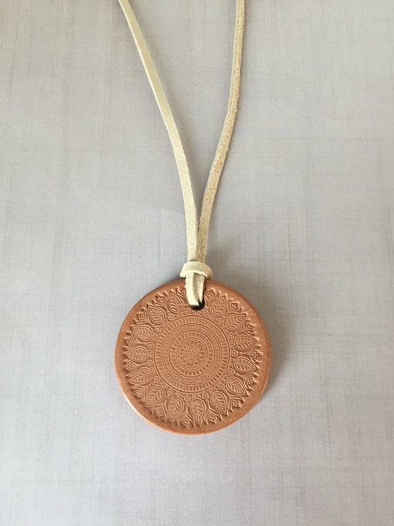 Terracotta Neck Pendant Diffuser ~ Tribal floral terracotta diffuser necklace by staggsquare