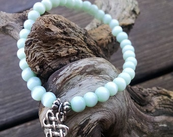 Seafoam Green Cat's Eye stretch beaded bracelet with Celtic Knot charm