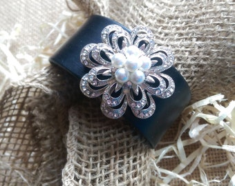 Leather Cuff Bracelet with Rhinestone and Faux Pearl Flower Centerpiece.