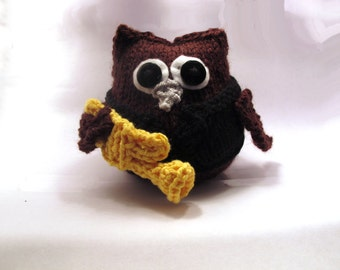 The Virt-hoo-oso: hand knitted owl toy with musical instrument
