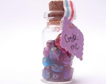 26 multi-coloured  iridescent glass beads
