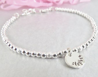Personalized Hand Stamped Name Charm. Sterling Silver Bead Layering Bracelet. Adornment for your wrist.