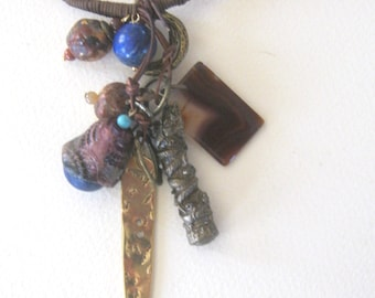 pendants and charms... ethnic and tribal elements.