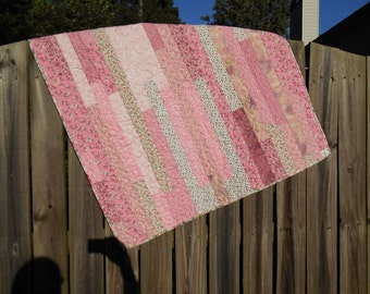 Adorable baby quilt in lovely pink, rose, and muave