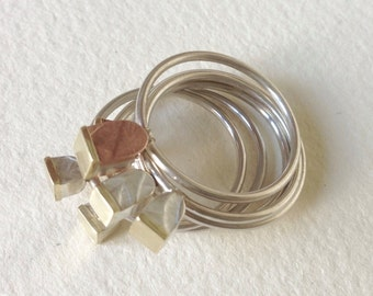 tiny 'cupcake' rings in silver copper and brass