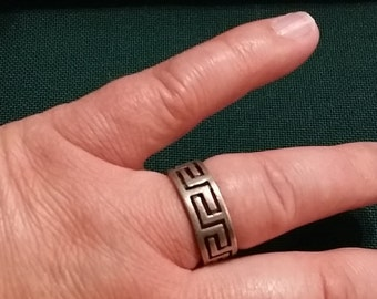 R 203   Man's Sterling silver ring with greek key design approx. size 9 3/4