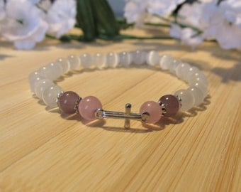 White, pink and lilac bracelet with a silver charm