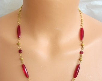 """Dark red, long chech beads (1"""") with dark red round chech beads, and a gold bead between each"""