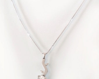 Diamond Flower Necklace ,solid white gold flower necklace with 25Pts diamond.