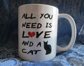 All You Need is Love and a Cat Ceramic Mug