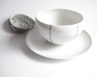 classic Eva Zeisel soup bowl with integral saucer