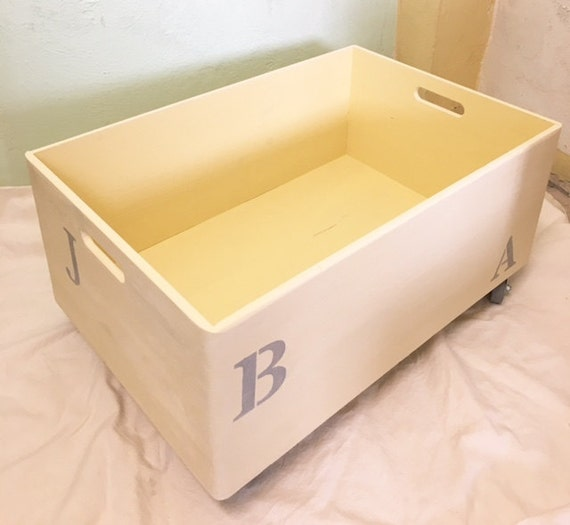 crate toy box with wooden wheels by bucotarlo on etsy. Black Bedroom Furniture Sets. Home Design Ideas