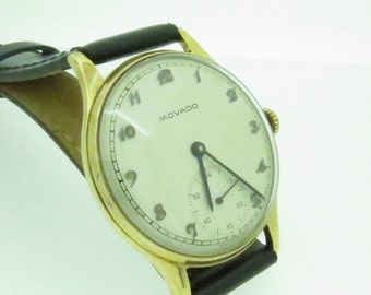 A classic Gents 9ct Gold Movado Watch