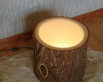 Tree trunk as a side table with bark and lighting