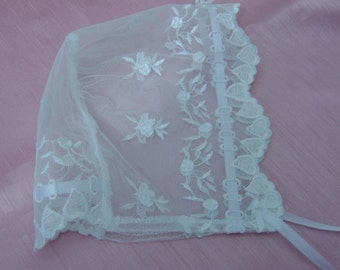 A Delicate White Lace Baby Bonnet 0-3 mths.