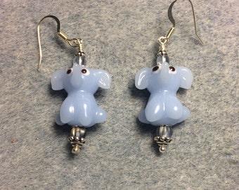 Opaque light blue lampwork sitting elephant bead earrings adorned with light blue grey Czech glass beads.