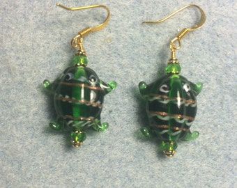 Green lampwork frog bead earrings adorned with green Chinese crystal beads.