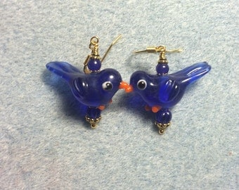 Blue translucent lampwork songbird dangle earrings adorned with blue Czech glass beads.