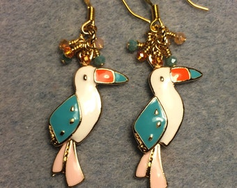 Peach, turquoise, and orange enamel toucan charm earrings adorned with tiny dangling peach, turquoise and orange Chinese crystal beads.
