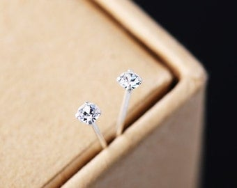 Sterling silver tiny zirconia stud earrings