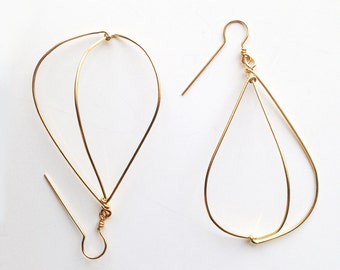 Gold plated geometrical earrings. Offered delivery.