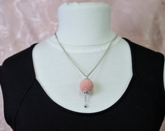 Necklace with wooden ball fragranced lined with crochet technique