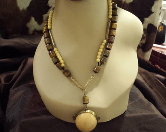Two strand beaded tiger eye and jade necklaces with vintage drop