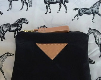 Leather clutch with horse design fabric lining