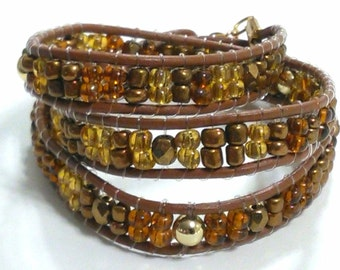 Handmade wrap bracelet with glass beads and brown leather cord