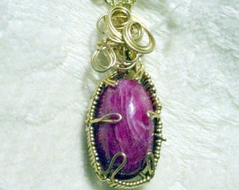 Wire Sculptured Madagascar Ruby Glass Filled Cabachon,34.09 Carats. Gold Filled