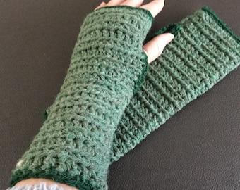 Crocheted green wrist warmers