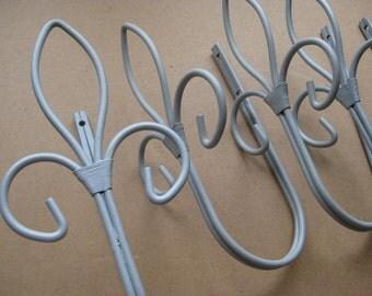 4 Vintage French decorative FLEUR DE LIS metal coat hooks.