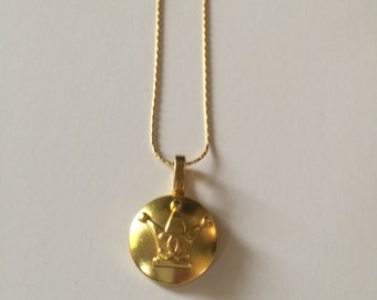 Gold Chanel button necklace pendant