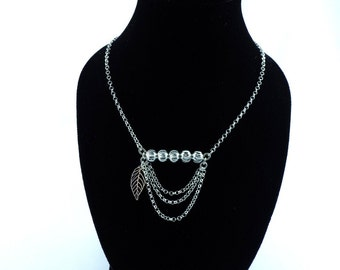 Necklace with pearls, chains and small sheet silver