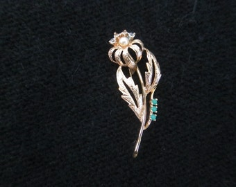 gold plated brooch and emeralds