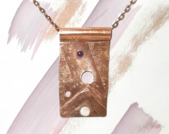Geometric collage in antiqued copper with amethyst cabochon