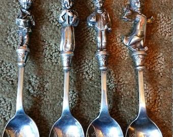 Set of 4 Reed and Barton Christmas Spoons