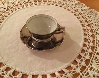 Vintage German Demitasse Tea Cup and Saucer.  Silver coated porcelain