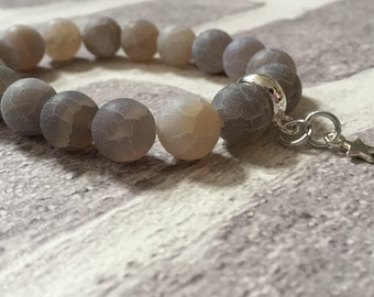 Grey and beige Agate bracelet with silver plated star charm