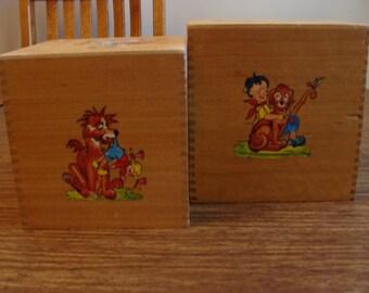 Vintage wood storage cubes with painted children's figure scenes