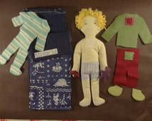 Cuddly toy : rag doll to dress up with scratches with his sleeping bag.
