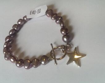 Freshwater pearl bracelet, dusky pink, star charm