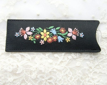 Vintage 1950's embroidered black silk comb case with comb.