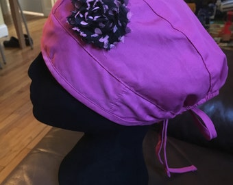 Pink tieback with black polka dot flower