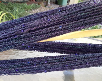Beaded handspun purple and green yarn, a soft mix of merino, alpaca, BFL, Shetland & bamboo, cobalt beads, plied with shiny cotton thread.
