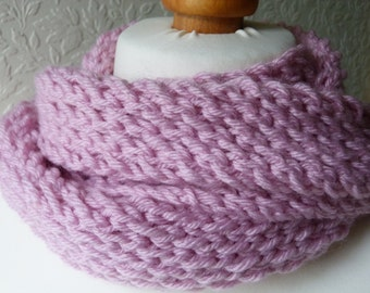 Chunky pale pink hand knitted scarf in a merino wool and acrylic mix yarn
