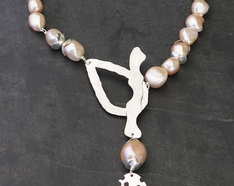 Silver necklace massif and pink Baroque pearls